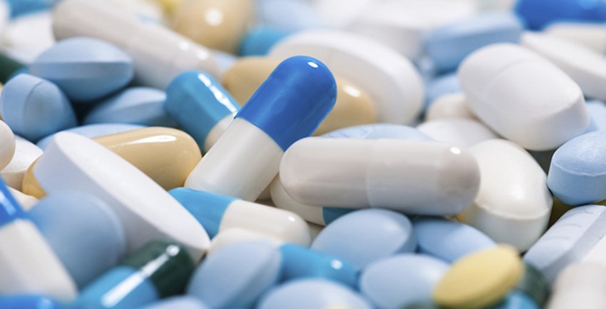 Heap of medicine pills. Close up of colorful tablets and capsules